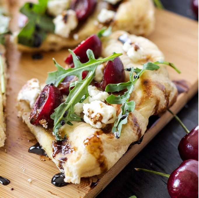 Grilled cherry arugula and goat cheese pizza