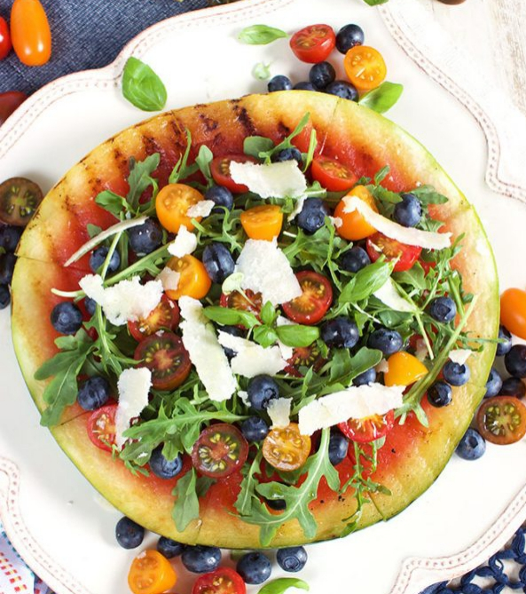 Grilled watermelon pizza with blueberries parmesan and arugula