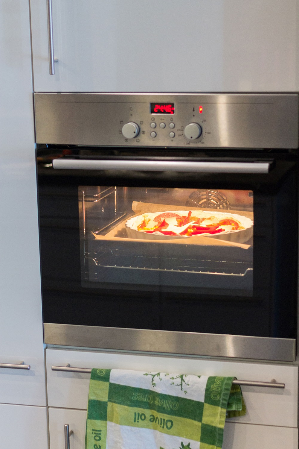 cooking pizza in Commercial Pizza Oven