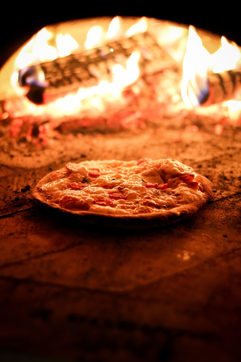 pizza in Wood Fired Pizza Oven